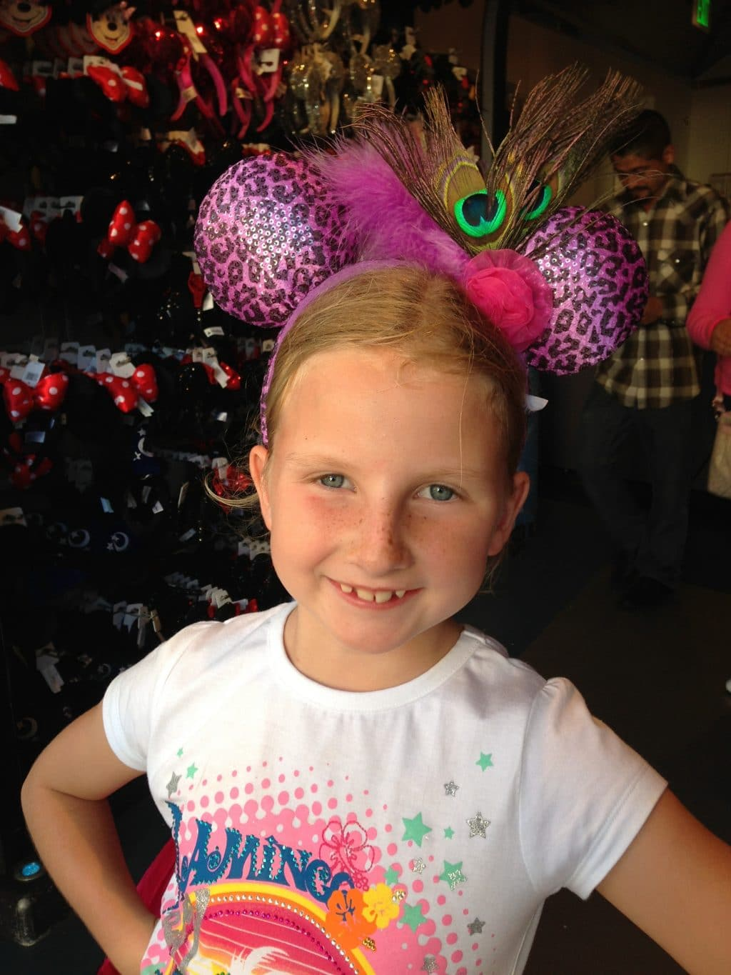 Charlotte-trying-on-Mickey-Mouse-ears